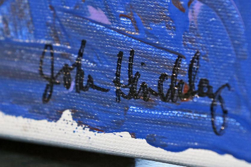 In this photo taken March 18, 2015, the signature on a painting by John Hinckley is seen in Hampton, Va. The man who tried to assassinate President Ronald Reagan may soon get the most freedom he's had since since the shooting outside a Washington hotel in 1981. (AP Photo/Steve Helber, File)