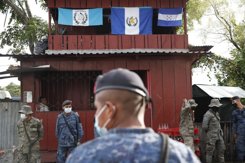 Soldiers stand in El Cinchado, Guatemala, on the border with Honduras, Friday, Oct. 2, 2020. Guatemala vowed to detain and return members of a new caravan of about 2,000 migrants that set out from neighboring Honduras in hopes of reaching the United States, saying they represent a health threat amid the coronavirus pandemic. (AP Photo/Moises Castillo)