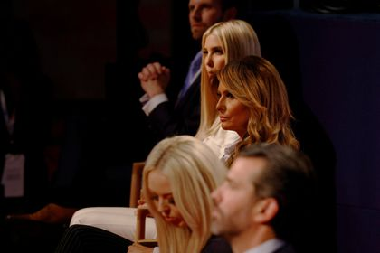 U.S. first lady Melania Trump watches after taking off her face mask while sitting with the rest of the Trump family, including Donald Trump Jr., Tiffany Trump, Ivanka Trump and Eric Trump, before the start of the first 2020 presidential campaign debate between U.S. President Donald Trump and Democratic presidential nominee Joe Biden in Cleveland, Ohio, U.S., September 29, 2020.   Picture taken September 29, 2020.     REUTERS/Brian Snyder