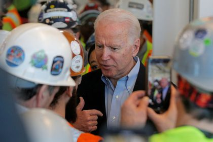 Democratic U.S. presidential candidate and former Vice President Joe Biden argues with a worker about his positions on gun control during a campaign stop at a plant in Detroit, Michigan