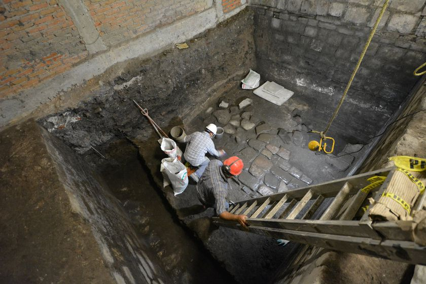 Archaeologists from Mexico's National Institute of Anthropology and History (INAH) work on slabs of basalt, belonging to vestiges of a pre-Hispanic palace and the residence of conqueror Hernan Cortes in Mexico City