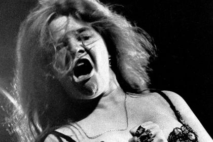 Blues/rock singer Janis Joplin performs at the Newport Folk Festival with her band Big Brother and the Holding Company.
