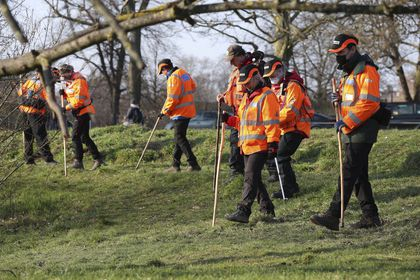 A search team near Eagle Pond on Clapham Common Sunday March 7, 2021, search for traces connected to missing 33-year old woman Sarah Everard, who has been missing since Wednesday.  Everard left a friend's house in Clapham, south London, on Wednesday evening to walk home has not been seen or heard from since. (Jonathan Brady/PA via AP)