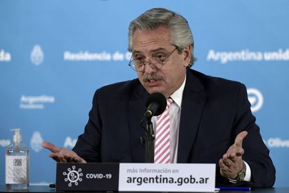 FILE PHOTO: Argentina's president, Alberto Fernandez, gestures during the announcement that Argentina and Mexico will produce and distribute an experimental coronavirus vaccine, at the Olivos Presidential residence, in Buenos Aires, Argentina August 12, 2020. Juan Mabromata/Pool via REUTERS/File Photo