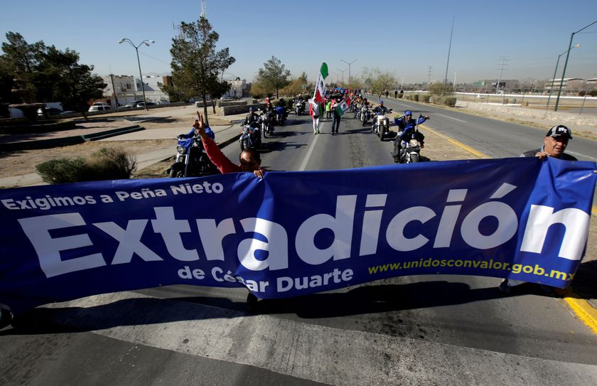 FILE PHOTO: People hold a banner as they take part in the 'March for Dignity' from the border city of Ciudad Juarez to the Finance Minister's premises in Mexico City