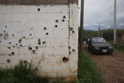 """Bullet holes scar a home's exterior wall, on the outskirts of the municipality of Valparaiso, Zacatecas state, Mexico, Wednesday, July 14, 2021. President Andres Manuel Lopez Obrador recognized that violence remains a problem. """"If we don't manage to pacify Mexico, regardless of what has been done, we are not going to be able to historically prove our government,"""" he said. (AP Photo/Marco Ugarte)"""