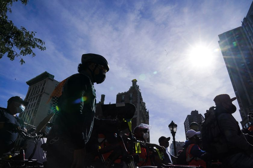 Bicycle delivery workers for restaurants and food applications protest to demand more protection during a wave of robberies of their electrical bicycles Thursday, Oct. 15, 2020, in New York. (AP Photo/Frank Franklin II)