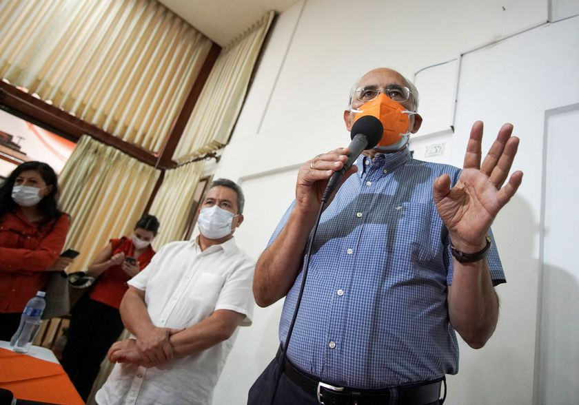 Presidential candidate Carlos Mesa of Citizen Community party addresses the media while candidate for Vice President Gustavo Pedraza looks on, in Santa Cruz, Bolivia September 18, 2020. REUTERS/Juan Pablo Roca  NO RESALES. NO ARCHIVES
