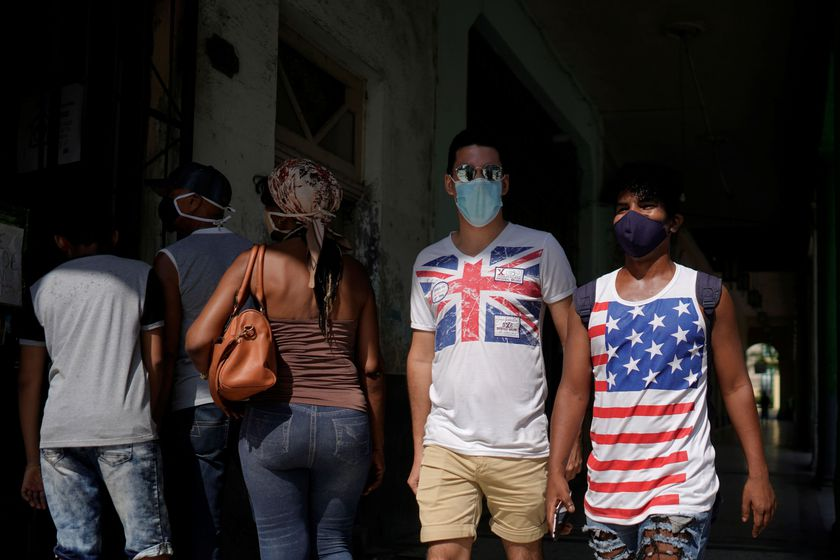 People wear T-shirts with Union Jack and a U.S. flag in downtown Havana, Cuba, October 31, 2020. Picture taken October 31, 2020. REUTERS/Alexandre Meneghini