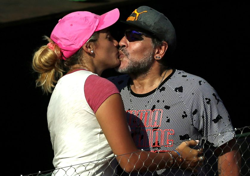 FILE PHOTO: Tennis - Argentina v Italy - Davis Cup World Group First Round - Parque Sarmiento stadium, Buenos Aires, Argentina - 3/2/17. Former Argentine soccer star Diego Maradona kisses his girlfriend Rocio Oliva. REUTERS/Marcos Brindicci/File Photo