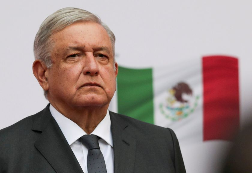 FILE PHOTO: Mexico's President Andres Manuel Lopez Obrador listens to the national anthem as he arrives to address the nation on his second anniversary as President of Mexico, at the National Palace in Mexico City, Mexico, December 1, 2020. REUTERS/Henry Romero/File Photo