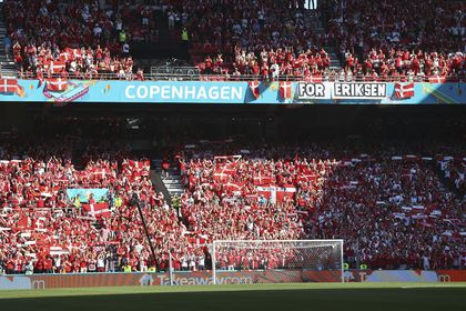 Denmark supporters display a banner for Christian Erikssen, the Danish player who collapsed during the match against Finland last Saturday, June 12, prior to the Euro 2020 soccer championship group B match between Denmark and Belgium, at the Parken stadium in Copenhagen, Thursday, June 17, 2021. (Wolfgang Rattay, Pool via AP)