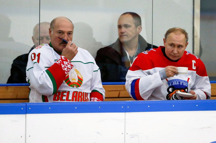 FILE PHOTO: FILE PHOTO: Russian President Vladimir Putin and Belarusian President Alexander Lukashenko take a break during a match of the Night Hockey League teams in Rosa Khutor in the Black Sea resort of Sochi