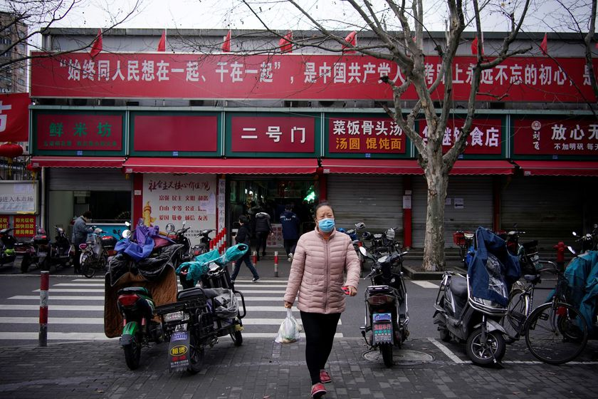 A woman wearing a protective face mask is seen at a residential community following an outbreak of coronavirus (COVID-19), in downtown Shanghai