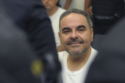 FILE - In this Aug. 8, 2018 file photo, El Salvador's former President Tony Saca attends a hearing at the Isidro Menendez Judicial Complex in San Salvador, El Salvador. The Central American country´s prosecutor´s office asked Monday, August 23, 2021, to exonerate Saca, who stands accused of embezzling public funds, after the statute of limitations have passed in the case against him and two other leaders of his political party. (AP Photo/Salvador Melendez, File)