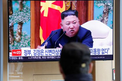 FILE PHOTO: South Korean people watch a TV broadcasting a news report on North Korean leader Kim Jong Un in Seoul