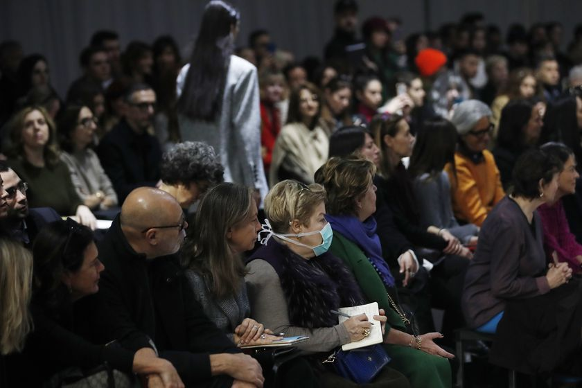 Spectators and journalist follow Drome's women's Fall Winter 2020-21 collection, presented in Milan, Italy, Sunday, Feb. 23, 2020. After Giorgio Armani's last-minute decision to show his latest collection in an empty theater due to concerns about the new virus, the rest of Milan's runway shows scheduled for Sunday are to go ahead as planned, fashion officials confirmed. (AP Photo/Antonio Calanni)