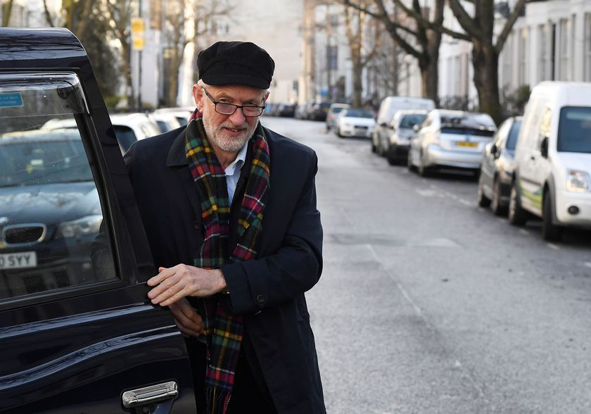 Britain's Labour Party leader Jeremy Corbyn gets out of a taxi near his home in London, Britain