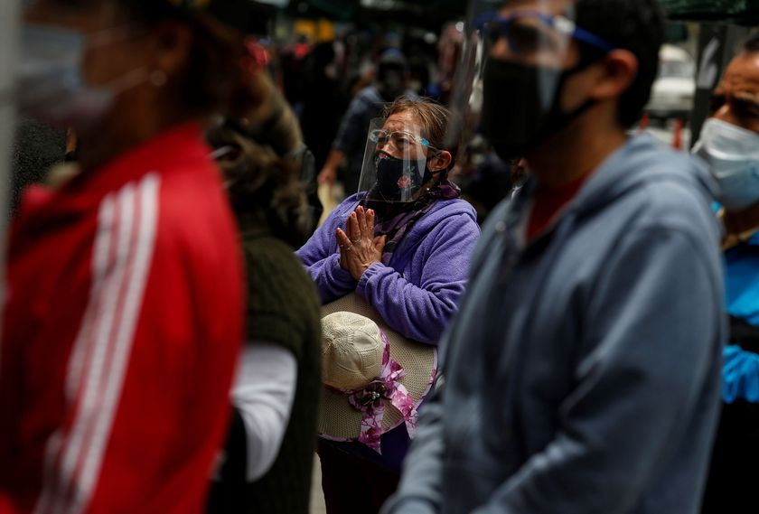 People pray outside the Monastery of the Nazarenes, as churches continue to be closed due to the coronavirus disease (COVID-19) outbreak, in Lima, Peru October 7, 2020.  REUTERS/Sebastian Castaneda  NO RESALES. NO ARCHIVES