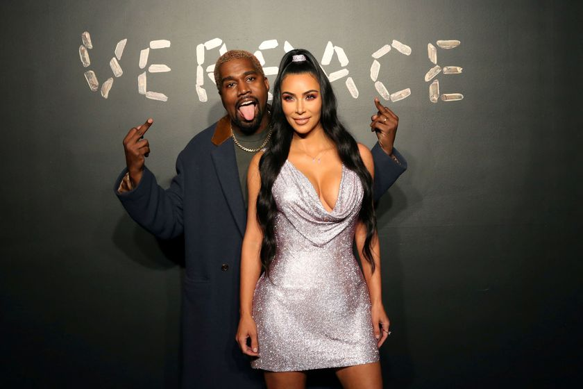 FILE PHOTO: Kanye West and Kim Kardashian pose for a photo before attending the Versace presentation in New York