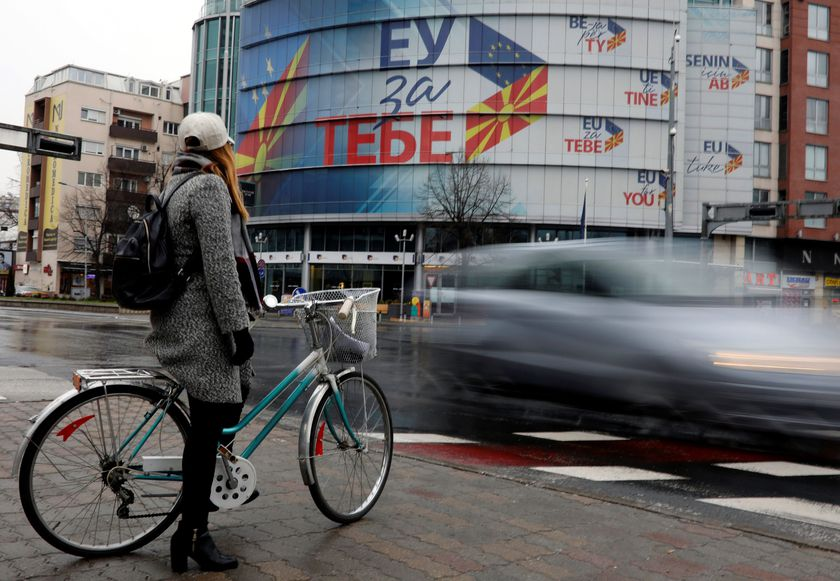 A girl stands with her bicycle near the offices of the Delegation of the European Union in Skopje