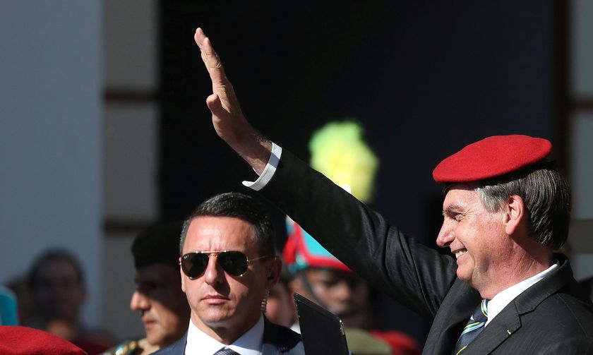 FILE PHOTO: Brazilian President Jair Bolsonaro wears a red beret as he attends a ceremony to celebrate the 130th anniversary of the Military School in Rio de Janeiro