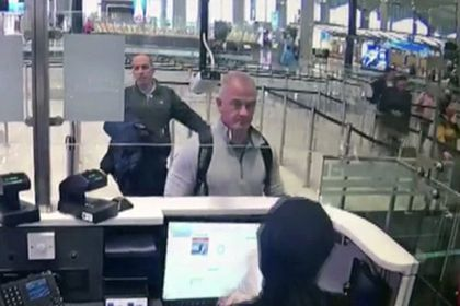 FILE — This Dec. 30, 2019, image from security camera video shows Michael L. Taylor, center, and George-Antoine Zayek at passport control at Istanbul Airport in Turkey. A Tokyo court handed down prison terms for the American father Michael Taylor and son Peter accused of helping Nissan's former chairman, Carlos Ghosn, escape to Lebanon while awaiting trial in Japan.(DHA via AP, File)
