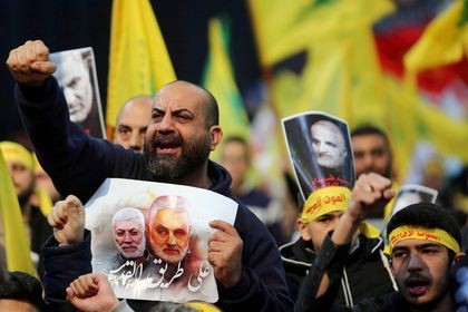 FILE PHOTO: FILE PHOTO: Lebanon's Hezbollah supporters chant slogans during a funeral ceremony rally to mourn Qassem Soleimani, head of the elite Quds Force, who was killed in an air strike at Baghdad airport, in Beirut's suburbs
