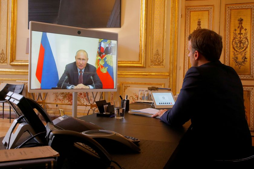 FILE PHOTO: French President Emmanuel Macron holds a video meeting with Russian President Vladimir Putin