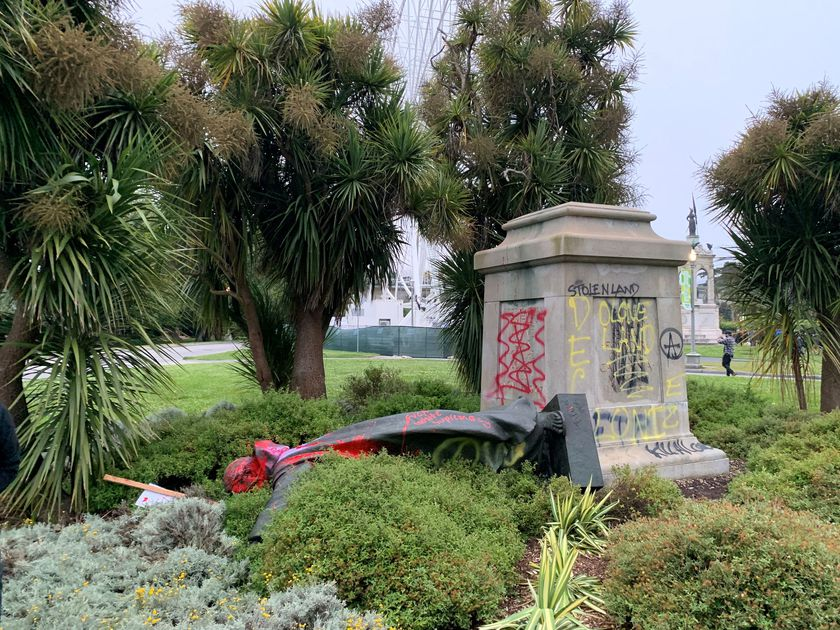 St Junipero Serra statue faces the ground memorial after being vandalised with red spray painting San Francisco