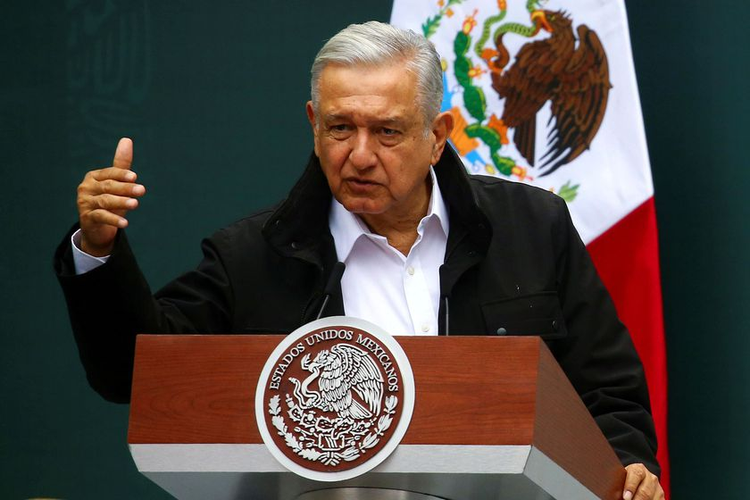 FILE PHOTO: Mexico's President Andres Manuel Lopez Obrador gestures as he speaks during the delivery of an investigation report with relatives of the 43 missing students of the Ayotzinapa Teacher Training College, marking the 6th anniversary of their disappearance, at the National Palace in Mexico City, Mexico September 26, 2020. REUTERS/Edgard Garrido/File Photo