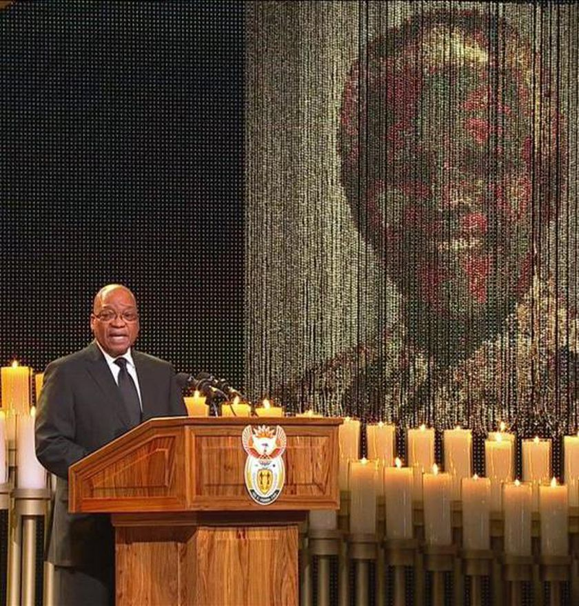 South African President Jacob Zuma sings during the funeral of former South African President Nelson Mandela in his ancestral village of Qunu in the Eastern Cape province, 900 km (559 miles) south of Johannesburg, in this still image taken from December 15, 2013 video courtesy of the South Africa Broadcasting Corporation (SABC). REUTERS/SABC via Reuters TV    (SOUTH AFRICA - Tags: POLITICS OBITUARY TPX IMAGES OF THE DAY)  ATTENTION EDITORS - FOR EDITORIAL USE ONLY. NOT FOR SALE FOR MARKETING OR ADVERTISING CAMPAIGNS. NO SALES. NO ARCHIVES. SOUTH AFRICA OUT. NO COMMERCIAL OR EDITORIAL SALES IN SOUTH AFRICA. THIS PICTURE WAS PROCESSED BY REUTERS TO ENHANCE QUALITY