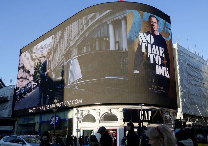 """A film trailer for the 25th instalment in the James Bond series entitled """"No Time to Die"""" is displayed at Piccadilly Circus in London."""