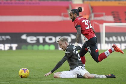 Southampton's Theo Walcott and Manchester United's Eric Bailly, left, vie for the ball during an English Premier League soccer match between Southampton and Manchester United at the St. Mary's stadium in Southampton, England, Sunday, Nov. 29, 2020. (Mike Hewitt, Pool via AP)