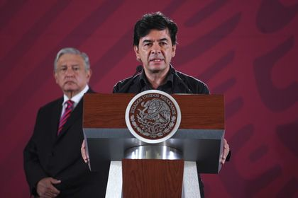 """FILE - In this Aug. 2, 2019 handout photo provided by Mexico's Presidential Press Office, flanked by Mexico's President Andres Manuel Lopez Obrador, Presidential Press Secretary Jesus Ramirez speaks during the daily press briefing at the National Palace in Mexico City. The government presented on Thursday, Nov. 26, 2020, an """"ethical guide"""" that it will distribute among the population and with which it hopes to contribute to promoting values that allow the country to be transformed. (Daniel Aguilar/Mexico's Presidential Press Office via AP File)"""