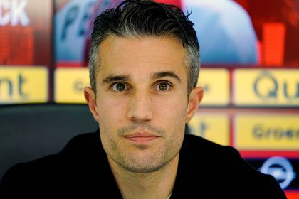 FILE PHOTO: Robin van Persie attends a news conference, after the Dutch player signed a contract with Feyenoord, in Rotterdam