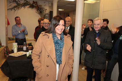 Paris' incumbent mayor and candidate for her own succession Anne Hidalgo is applauded as she arrives at her campaign headquarters, in Paris