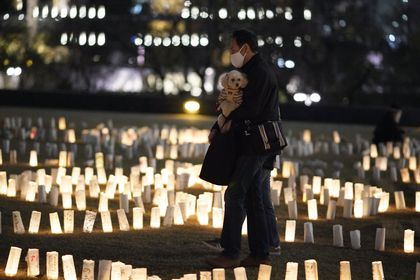Tokyo (Japan), 10/03/2021.- A visitor walks through paper lanterns lit for the victims of the 2011 Great East Japan Earthquake in Tokyo, Japan, 10 March 2021, on the eve of the 10th anniversary of the devastating earthquake and tsunami. More than 2000 candles with messages are displayed until 11 March 2021 to mark the 10th anniversary of the Great East Japan Earthquake. (Terremoto/sismo, Japón, Tokio) EFE/EPA/FRANCK ROBICHON