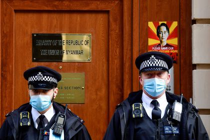 Police officers stand guard outside the Myanmar Embassy in London, Britain, April 8, 2021. REUTERS/Toby Melville