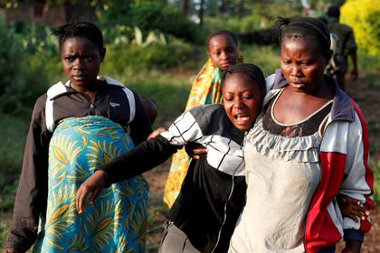 FILE PHOTO: A woman reacts after five other women were killed in Paida, near Beni