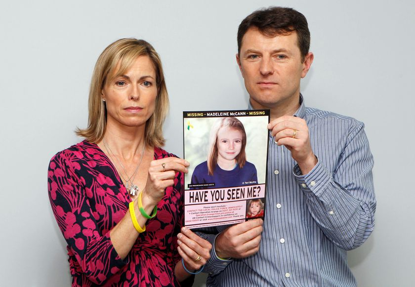 FILE PHOTO: Kate and Gerry McCann pose with a computer generated image of how their missing daughter Madeleine might look now, during a news conference in London