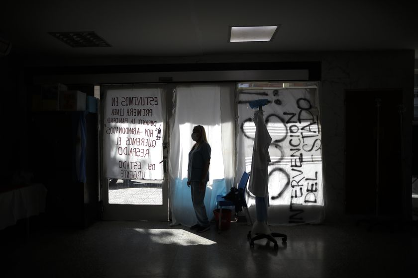 Nurse Lidia Del Valle stands inside San Andres Clinic which has been occupied by its former workers since it closed at the start of the year following the death of the hospital's director and owner in Caseros, Argentina, Friday, April 30, 2021. While the pandemic has swelled the need for hospital beds, many private clinics say they're struggling to survive, citing the pandemic having pushed away many non-COVID patients and losing money on coronavirus sufferers because the government insurance program doesn't pay enough to meet costs. (AP Photo/Natacha Pisarenko)