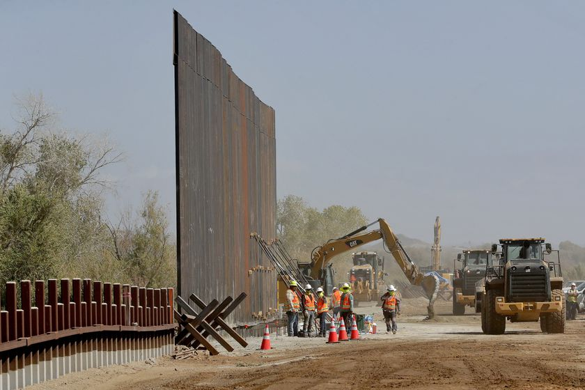 FILE - In this Sept. 10, 2019 file photo government contractors erect a section of Pentagon-funded border wall along the Colorado River in Yuma, Ariz. The federal Bureau of Land Management said on Tuesday, July 21, 2020, it's transferred over 65 acres of public land in Arizona and New Mexico to the Army for construction of border wall infrastructure. (AP Photo/Matt York,File)