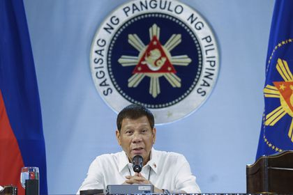In this photo provided by the Malacanang Presidential Photographers Division, Philippine President Rodrigo Duterte gestures as he meets members of the Inter-Agency Task Force on the Emerging Infectious Diseases at the Malacanang presidential palace in Manila, Philippines on Monday Dec. 7, 2020. The Philippine president has ruled out any ceasefire and a resumption of long-stalled peace talks with communist guerrillas and renewed a vow to destroy the insurgents in his last two years in office. (King Rodriguez/Malacanang Presidential Photographers Division via AP)