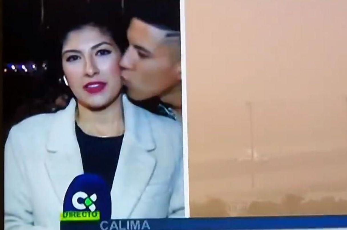 A stranger kisses a reporter from Radio Televisión Canaria while he was live