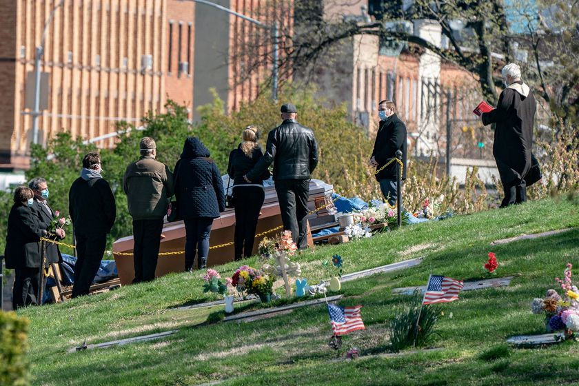 Mourners attend a funeral at The Green-Wood Cemetery during the outbreak of the coronavirus disease (COVID-19) in the Brooklyn borough of New York City