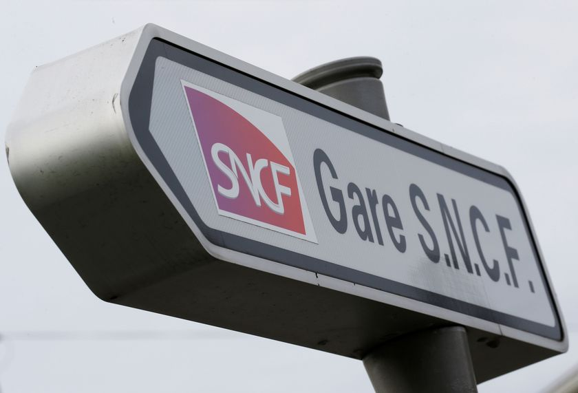 The logo of French state-owned railway company SNCF is pictured at Bordeaux railway station during a strike by French SNCF railway workers in Bordeaux