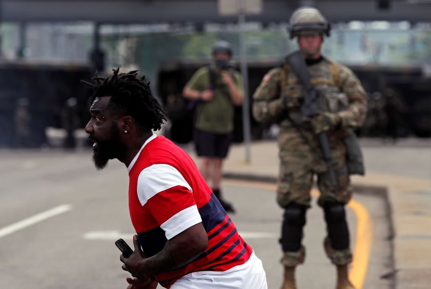 Man reacts as he confronts National Guard members guarding the area in the aftermath of a protest, in Minneapolis