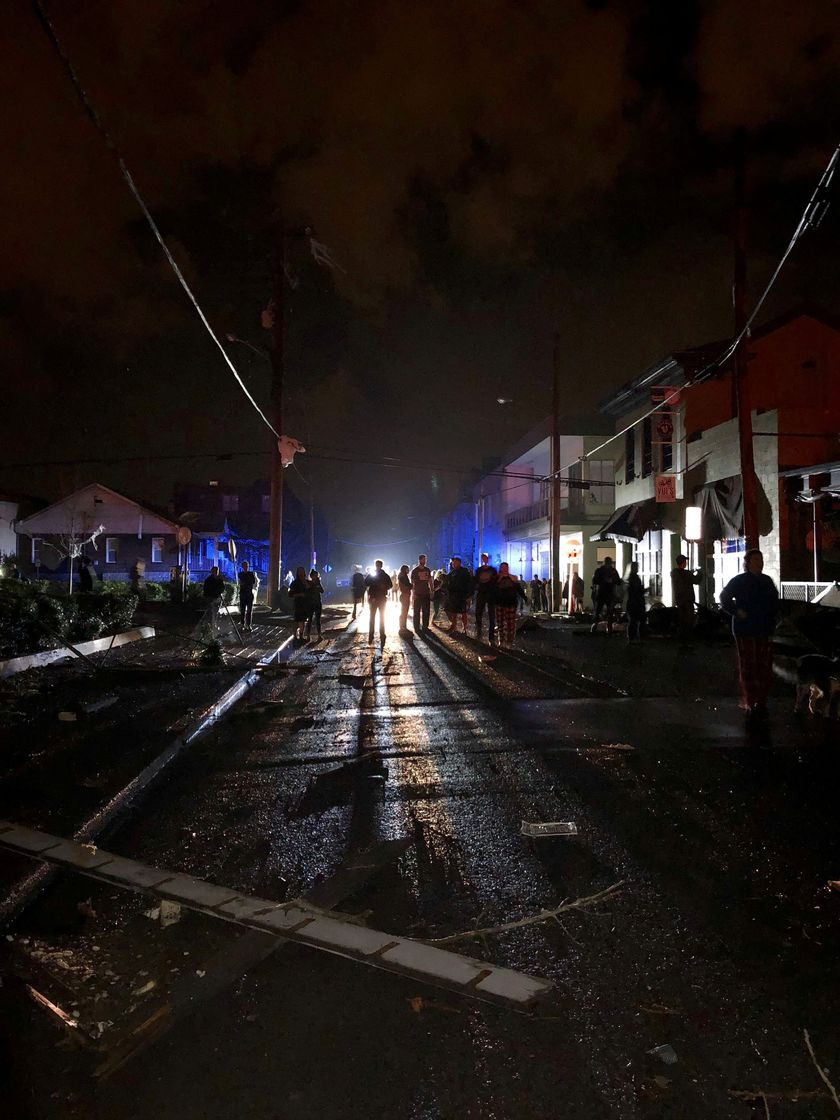 People gather amid damages caused by a tornado in Nashville