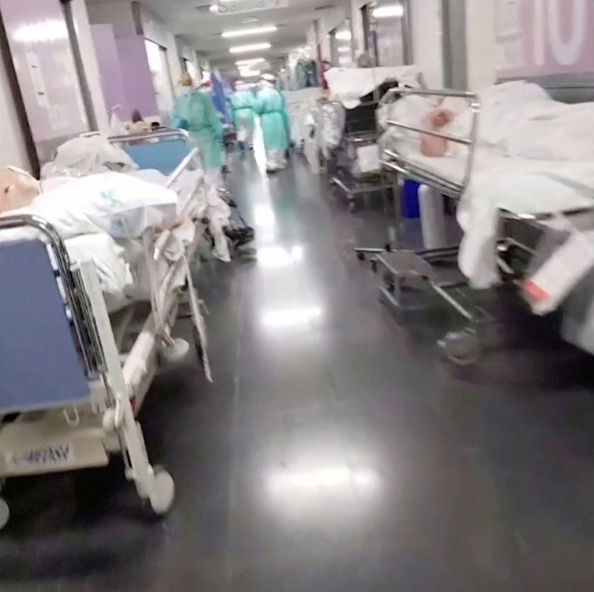 General view of a corridor with patients and medical personnel at an emergency unit of a Spanish hospital in Getafe, outside Madrid